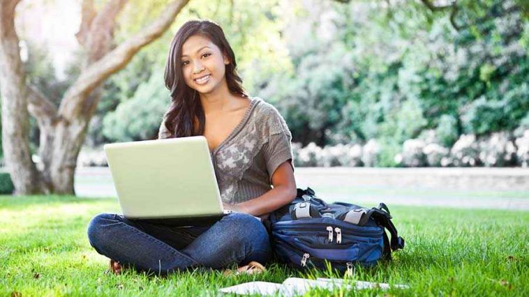 girl-on-lawn-with-laptop